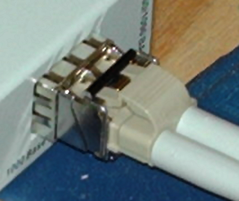 Fiber connects to SFP module, inserted into media converter